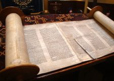 Is it true a woman is not permitted to touch a Sefer Torah?