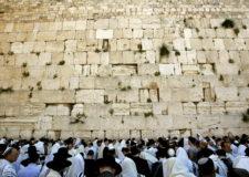 26 Apr 2005, JERUSALEM, Israel --- Ultra-Orthodox Jewish men pray during Passover prayers at the Western Wall in Jerusalem's Old City April 26, 2005.  --- Image by © OLEG POPOV/Reuters/Corbis